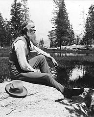 This photograph of John Muir sitting on the bank of a river was taken c. 1902 is in the U.S. Library of Congress. It is in the public domain.