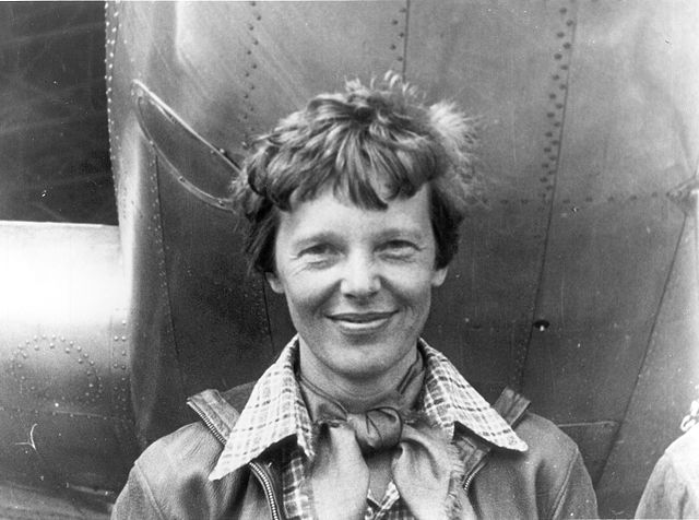 This image is of Amelia Earhart standing under the nose of her Lockheed Model 10-E Electra. It is a gelatin silver print taken in 1937 and is housed in the National Portrait Gallery of the Smithsonian Institution.  It was a gift from George R. Rinhart, in memory of Joan Rinhart. It is in the public domain in the United States because it was published between 1923 and 1977 without a copyright notice.