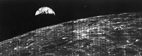 This crescent of the Earth was photographed August 23, 1966 at 16:35 GMT when the spacecraft was on its 16th orbit and just about to pass behind the Moon.