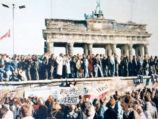 The Fall of the Berlin Wall, 1989 is has been permanently placed in the public as part of a public photo documentation wall at the Brandenburg Gate, Berlin.    It is the work of Lear 21 at English Wikipedia and is available under a Creative Commons Attribution-Share Alike 3.0 unported 3.0 Generic License.