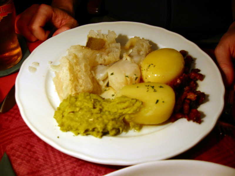 Lutefisk served with potatoes and mashed peas.