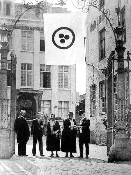 Delegates of second international conference dedicated to the Roerich Pact. Bruges, August 1932. Above them hangs a banner of peace.